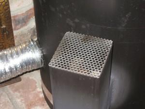 Rocket stove spark shield